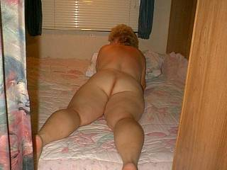 I love to see a lady naked, on her belly, with her ass facing up...so easy to see and to play with.
