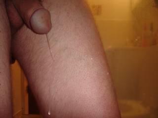 A long strand of pre-cum dripping down my leg