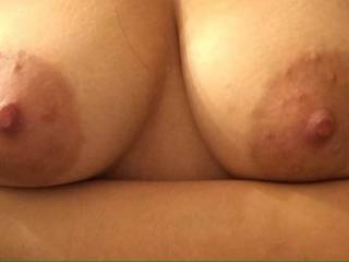 WOW!  Your tits are simply magnificent...perfect size, shape, big aerolas (my favorite!) and deliciously hard nipples just begging to be licked, sucked and nibbled on!!