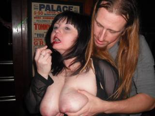 Trying to correct her makeup while the guy grabs her boobs?.........lol....she is unbelievable!