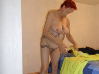Hi all  just getting dressed for a day out on the beach comments welcome mature couple