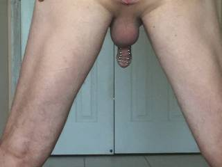 me bent over spreading my ass to show my glass butt plug gaping me and pierced dick