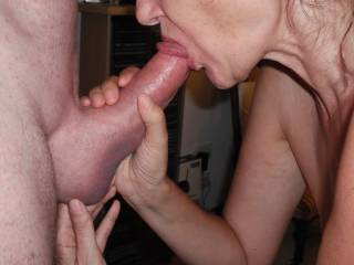 Sucking our swinger friend's extra thick cock when he came around for a threesome with us.