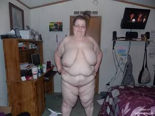 Would love to bend her over the bed and ram my bare cock into her , reaching under to feel her massive udders and rolls of belly fat swinging with every stroke and feeling those thick meaty thighs wobble until i unloaded my sperm deep inside your wife's big beautiful pussy and all this while you watched  !