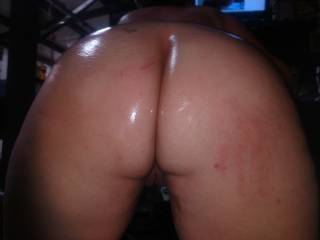 I had slap that ass once she stuck her ass in my face and teased me with a pussy flash. What would you have done if her ass was n your face all oil up asking for fick.?