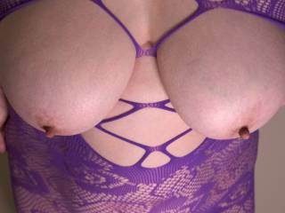 Another shot of my tits in the purple fishnets