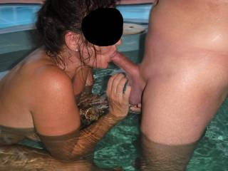 Sucking his lovely smooth shaven cock in the spa at home. Playing with his lovely big low hanging balls at the same time.