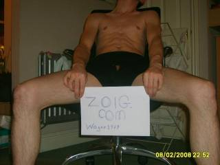 The boxers off shot is nicer, holding the sign to one side would be better yet.