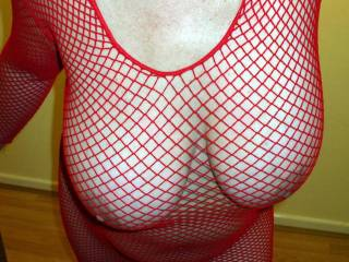 Very lovely and hot!  Great tits and she looks so good in red