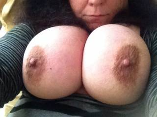 I would love to lick, nibble and suck those nipples.  Then slide my rock hard cock between those awesome tits and fuck them until I shoot my hot load all over them.