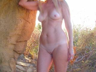 Gisela never misses a chance to soak up the sun on her beautiful naked skin! Her pussy hair is so fine, that it appears as if she shaves, but she doesn\'t