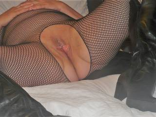 Getting ready to go out in my fishnet bodystocking and boots.