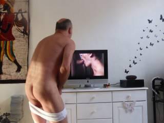 Masturbating front of porn vid