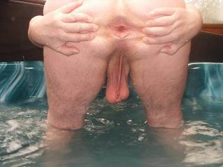 Spreading my ass cheeks and showing my hole and balls in the private jacuzzi of a couple of friends of mine