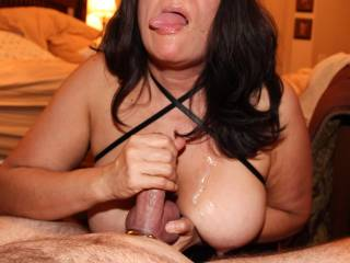 I stroked his cock until he shot his cum on my tits, then I sucked his cock until I got a mouthful of cum along with a facial, and now I'm jerking him off again to see how much I can get out of his hard cock!