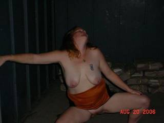 My wife LittleRed showing off on the roadside.  We stopped into this little shelter on the way home from a swingers party.
