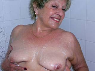 I'd love to get into the shower with you, I'm sure your wet body on my wet body would feel fabulous. This is a terrific pose by the way...love that smile. :-)