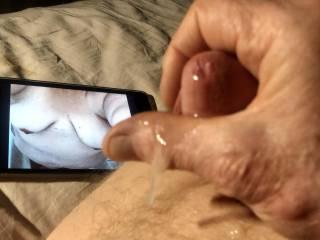 Jizz dripping off my hand after an intense orgasm.
