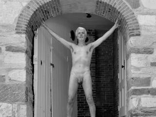 Posing naked in the doorway of this historical one-room school in Sudbury, Vermont.  Unfortunately, the small size of the photo here make it look as if my right eye is swollen shut or something.