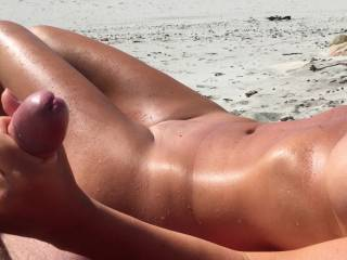 Relaxing hand job on a warm summer day at nude beach