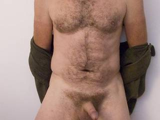 Showing my nude body to you.Makes me hard to think you are looking.