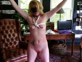 after a little contest, she is waiting for me to make her pay for not winning.  The contest?  10 Minutes tied as she is, with a vibrating massager on her pussy, and held to her clit at times.  I used it for 10 minutes.  She was told not to cum if possible