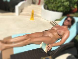 Laying by the pool at Desire Pearl Resort is so HOT.  You're in the pool and glance my way, I slightly open my legs to let you get a peek at my pussy which by now is dripping wet from all of the nakedness around and the alcohol being consumed.