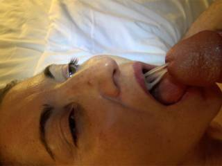 Mia looks up at me as the first blast of cum fills her mouth