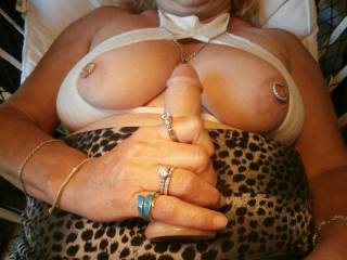 She teasing me and showing off. Talking about her jewels and what it would look like holding a cock.
