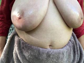3 of 4 - a nice simple video, made two days ago. With tits already oiled, I hand my friend a soft towel to wipe them with - and she puts it in her pocket for use later. So for the moment here again are her big shiny tits in sunlight