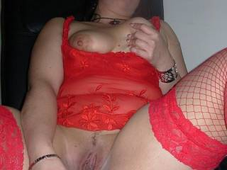 Our friend Kenia gets our glass dildo and starts playing!!We love her red lingerie