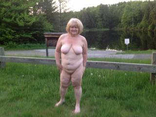 I am running around nude at boat ramp where some guys are fishing acroos the way on lake edge. Cars are coming and going in area. My husband hopes some guys catch me and gangbang my ass and pussy full of cum for being so bad in public. What do you think?
