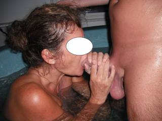 Sucking his lovely smooth hard cock in the spa at home.