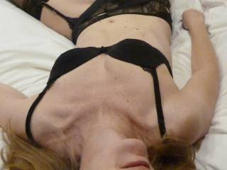 relaxing on bed waiting to be fucked in lingerie and stockings