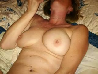 Round two after I finished fucking her with her double sided toy and cumming on her beautiful breasts. Who else would like to cum all over them?