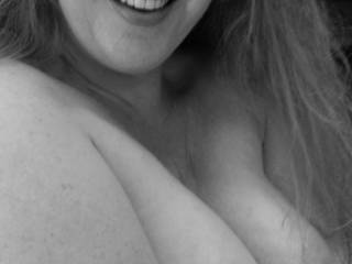 B&W of her amazing pregnant rack and her beautiful smile