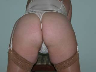 White basque, thong and tan lacy top stockings.