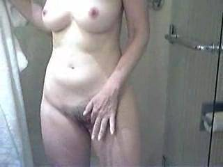 Polly takes a shower.  She loves fingering herself to orgasm in the shower, especially with the help hand sprays and dirty thoughts!  What a smile on her beautiful face as she emerges!  And a quick cunt check - things are ready for the next fucking!