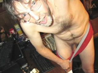 Standing near my desk as I pull my underwear down in a full body shot to reveal my dick.