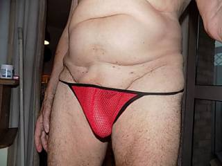 new red thong fits cock nicely very comfortable but it needs to be pulled down to let my cock out