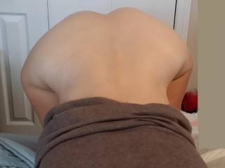 I am bent over on the edge of the bed. What are you thinking?