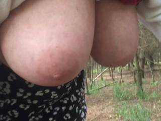 Twice hanging - my friend has tucked her top up so her tits can be more clearly seen when they are hanging. But halfway through the video it slips out, so she stops and stands up to tuck it in again. Then bends down again.