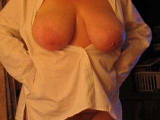 A beautiful pair, wow. Love the nipples and a nice glimpse of pussy.
