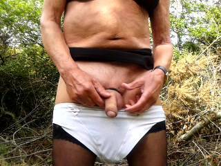 In my secluded woods, cross dressed and making the most of my well oiled large dildo, which I love to sit back on and give my self a nice thrill.  Waiting for some horny guy to come and give me the same treatment.  james