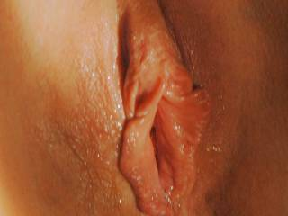 Had to give you my view as I licked and tasted that pretty wet pussy. What an afternoon delight using my tongue to separate those pussy lips and sucking gently on her clit. Makes my cock hard just thinking about it. Love to eat the pussy.