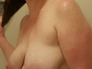 My big heavy milk filled tits swing when I comb out my hair... you should see!