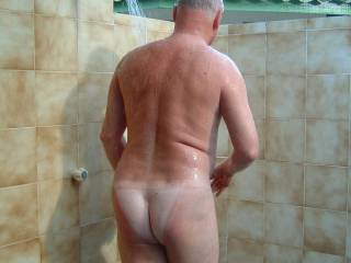 Taking an outdoor shower on holiday