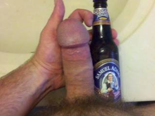 Not sure about the beer but i bet that hot cock taste sweet!!