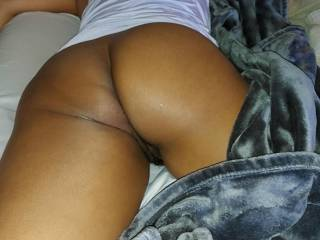 Wife laying across the bed
