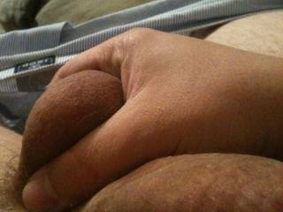 Squeezing the balls Trying to hold back from cumming